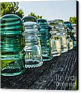 Pretty Glass Insulators All In A Row Canvas Print by Deborah Smolinske