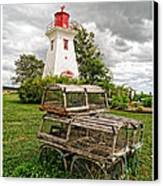 Prince Edward Island Lighthouse With Lobster Traps Canvas Print by Edward Fielding