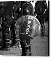 Psni Officer In Full Riot Gear With Shield On Crumlin Road At Ardoyne Shops Belfast 12th July Canvas Print by Joe Fox