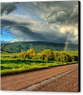 Rainbow After The Storm Canvas Print by John McArthur