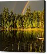 Rainbows Over Otter Lake Canvas Print by Thomas Pettengill