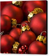 Red Christmas Baubles Canvas Print by Anne Gilbert