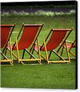Red Deck Chairs On The Green Lawn Canvas Print
