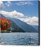 Red Flowers By Lake Como Italy Canvas Print by Anna-Mari West