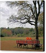 Red Pumpkin Wagon Canvas Print by Paulette Maffucci