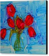 Red Tulips With Blue Background Canvas Print by Patricia Awapara