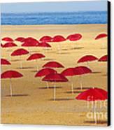 Red Umbrellas Canvas Print by Carlos Caetano
