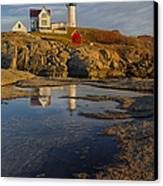 Reflecting On Nubble Lighthouse Canvas Print by Susan Candelario