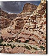 rock landscape with simple tombs in Petra Canvas Print by Juergen Ritterbach
