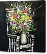 Rocking Chair With Flowers Canvas Print by Kendra Sorum