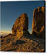 Roque Nublo Farther And Sun Monoliths At Sunset Canvas Print by Ben Spencer