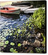 Rowboat At Lake Shore At Dusk Canvas Print by Elena Elisseeva
