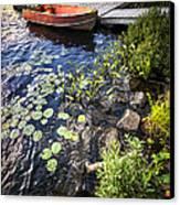 Rowboat At Lake Shore Canvas Print by Elena Elisseeva