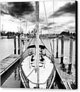 Sailboat Docked Canvas Print by John Rizzuto