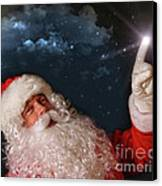 Santa Pointing With Magical Light To The Sky Canvas Print by Sandra Cunningham
