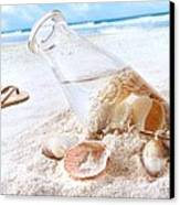 Seashells In A Bottle On The Beach Canvas Print by Sandra Cunningham