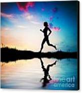 Silhouette Of Woman Running At Sunset Canvas Print