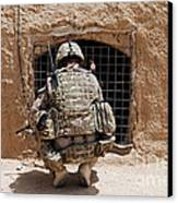 Soldier Searches A Compound Canvas Print by Stocktrek Images