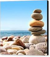 Stack Of Pebble Stones On White Canvas Print by Sandra Cunningham