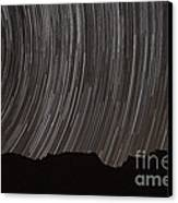 Star Trails Above A Valley Canvas Print by Amin Jamshidi