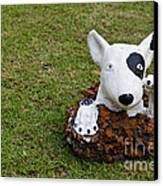 Statue Of A Dog Decorated On The Lawn Canvas Print by Tosporn Preede