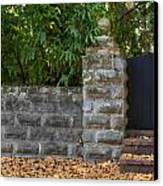 Stone Wall And Gate Canvas Print by Rich Franco