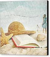 Straw Hat And Book In The Sand Canvas Print by Sandra Cunningham