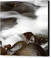 Stream Flowing  Canvas Print by Les Cunliffe
