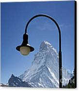 Street Lamp And Mountain Canvas Print by Mats Silvan