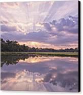 Sun Setting Over Pond Canvas Print by Bonnie Barry