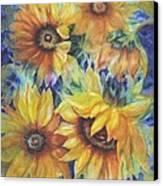 Sunflowers On Blue Canvas Print by Ann Nicholson