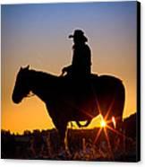 Sunrise Cowboy Canvas Print by Inge Johnsson