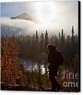 Sunrise Hiker Canvas Print by Chris Heitstuman