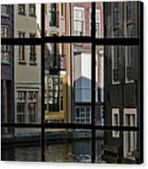 Swans Love Amsterdam Canvas Print by Joan Carroll