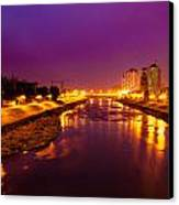 The Vardar River In Skopje At Night. Canvas Print by Slavica Koceva