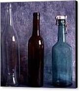 Three Old Empty Bottles On Painted Background Canvas Print by IB Photo