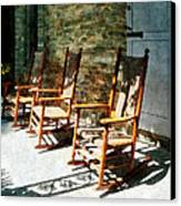 Three Wooden Rocking Chairs On Sunny Porch Canvas Print by Susan Savad