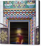 Tibetan Monk And The Prayer Wheel Canvas Print by Tim Gainey