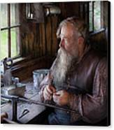 Tin Smith - Making Toys For Children Canvas Print by Mike Savad