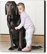 Toddler With Dog Canvas Print by Justin Paget