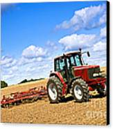 Tractor In Plowed Farm Field Canvas Print by Elena Elisseeva