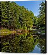 Trees Reflected On Mirrored Lake  Canvas Print by Amy Cicconi