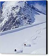 Two Young Men Skiing Untracked Powder Canvas Print by Henry Georgi Photography Inc