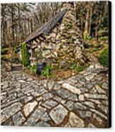 Ugly Cottage Canvas Print by Adrian Evans
