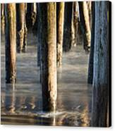 Under The Wharf Canvas Print by Dayne Reast
