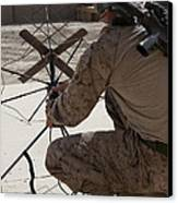 U.s. Marine Repositions A Satellite Canvas Print by Stocktrek Images