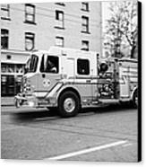 Vancouver Fire Rescue Services Truck Engine 2 Speeding Through Downtown City Streets Bc Canada Delib Canvas Print by Joe Fox