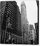 view of pennsylvania bldg nelson tower and US flags flying on 34th street from 1 penn plaza Canvas Print by Joe Fox