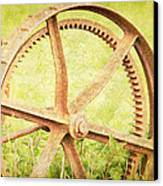 Vintage Rusty Wheel Canvas Print by Lesley Rigg
