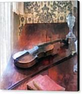 Violin On Credenza Canvas Print by Susan Savad